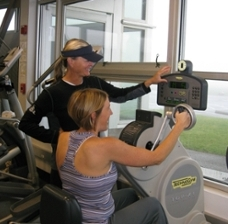 Fitness Trainer Kimball Barton assists a client